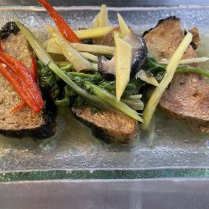 Steamed fish stired fried with ginger